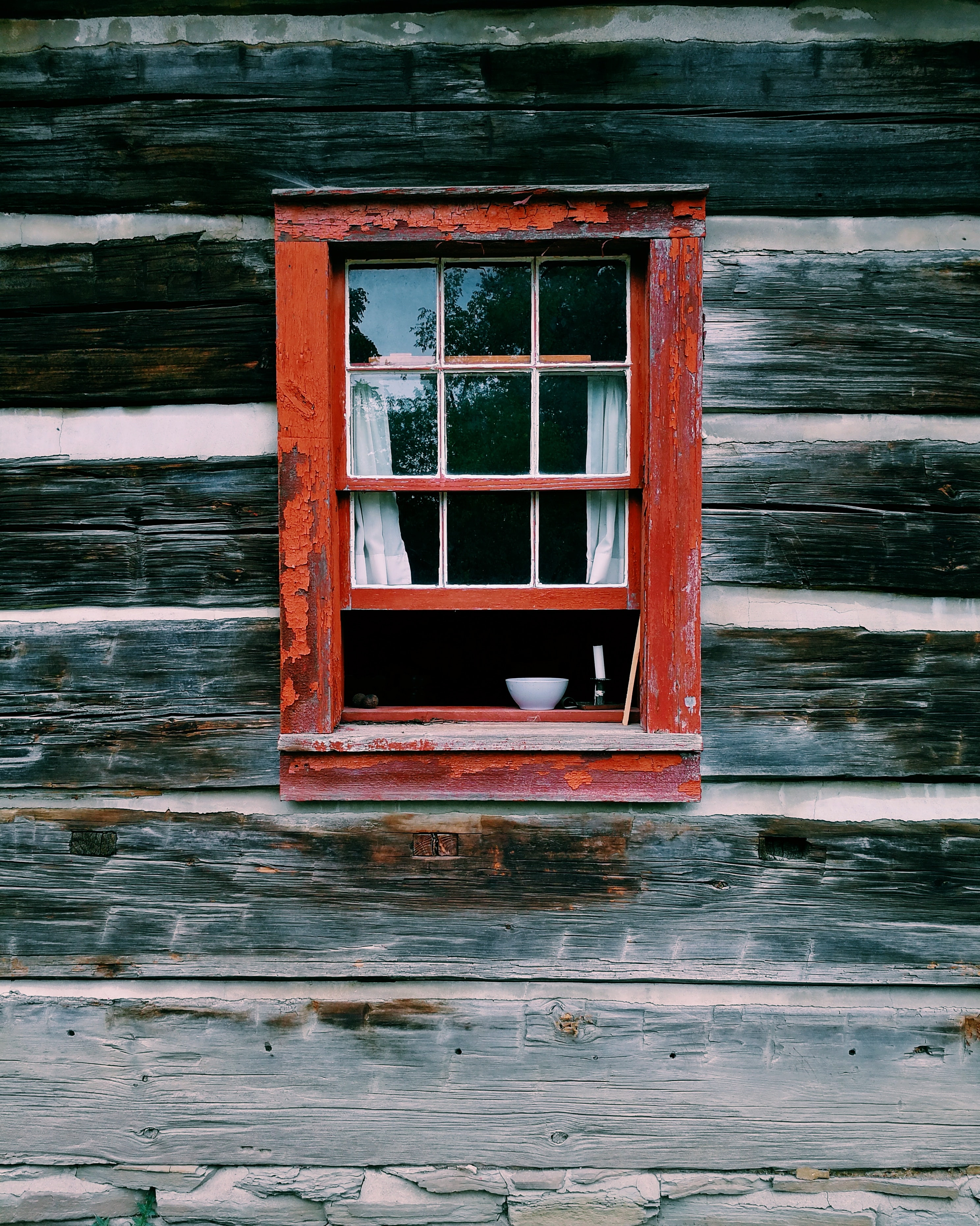 red wooden window frame