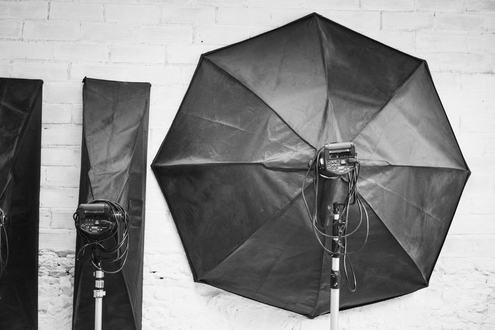 grayscale photography of studio lights