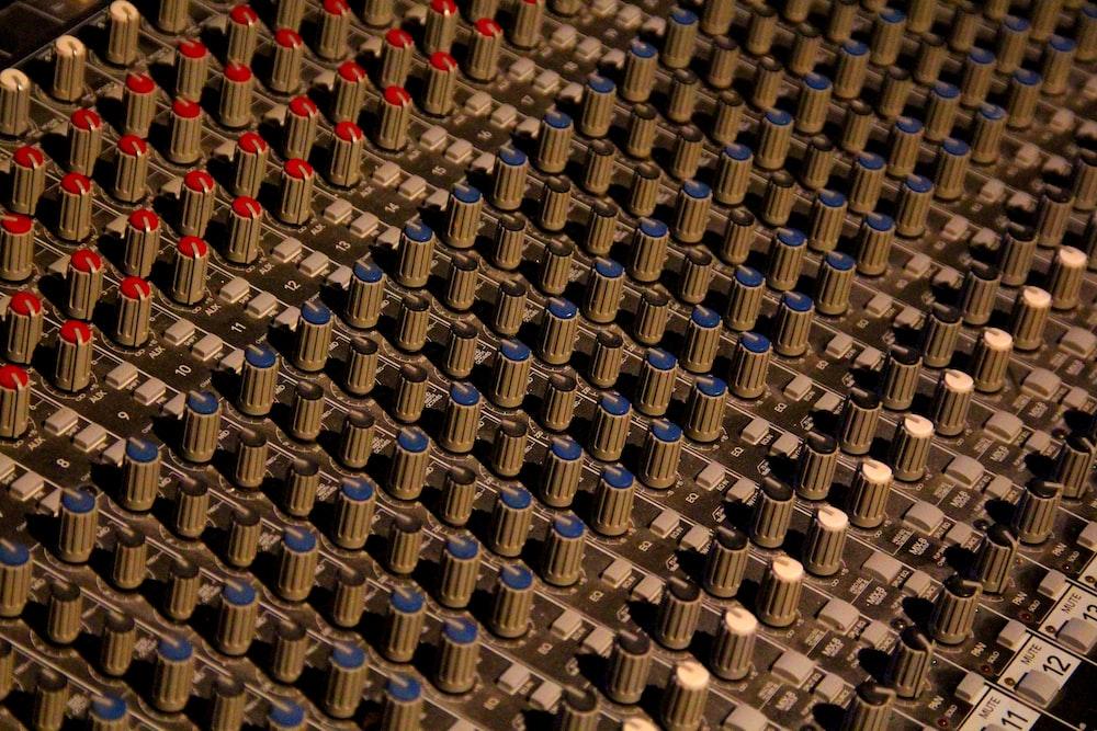 gray and blue DJ mixer