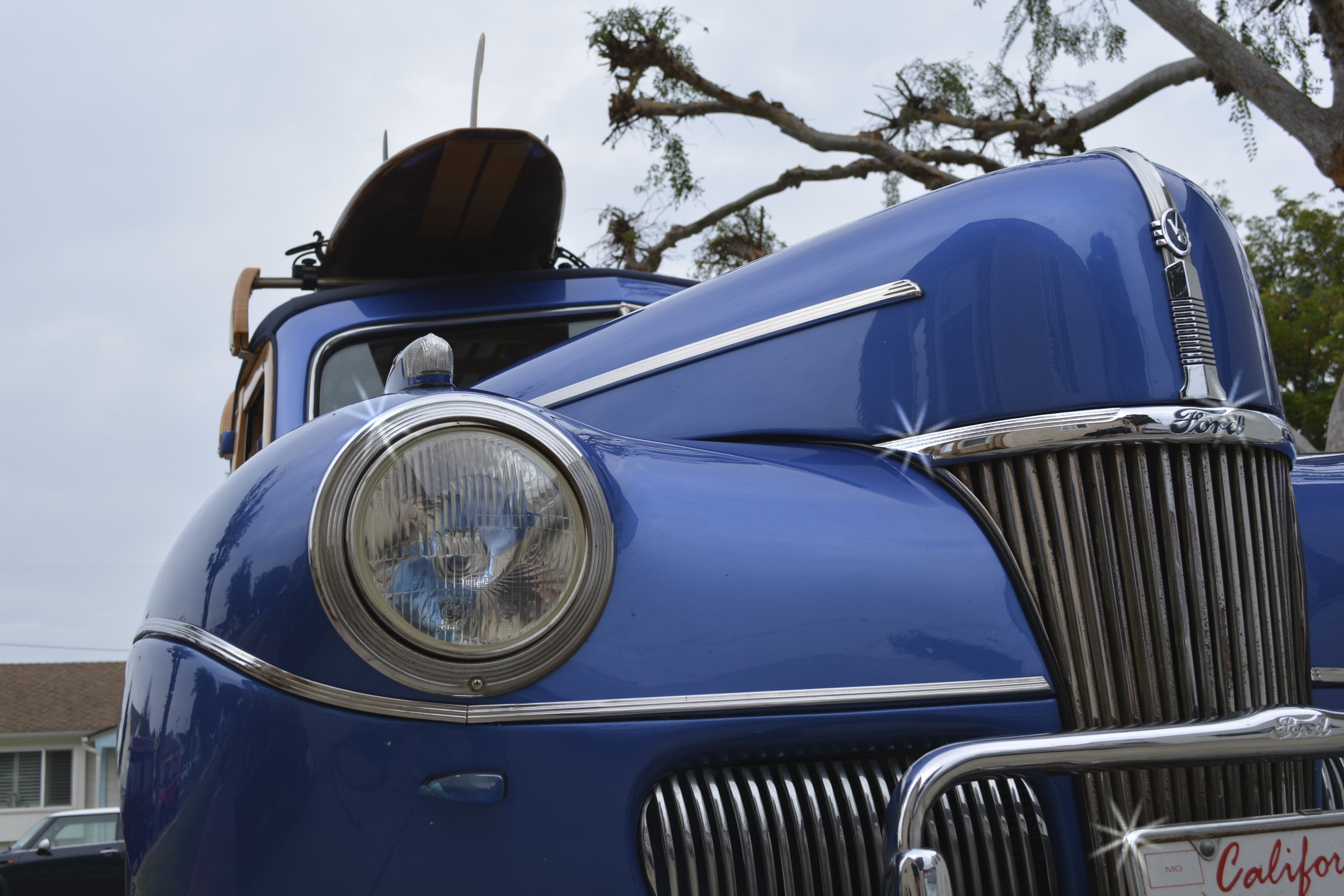 low-angle photo of classic blue vehicle during daytime