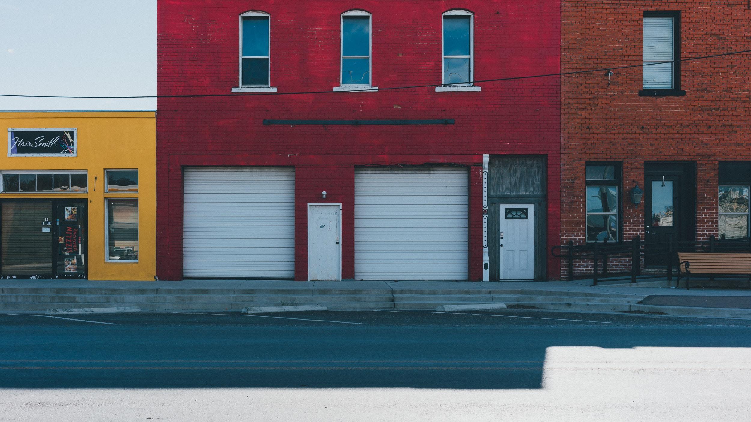 white garage doors closed during daytime