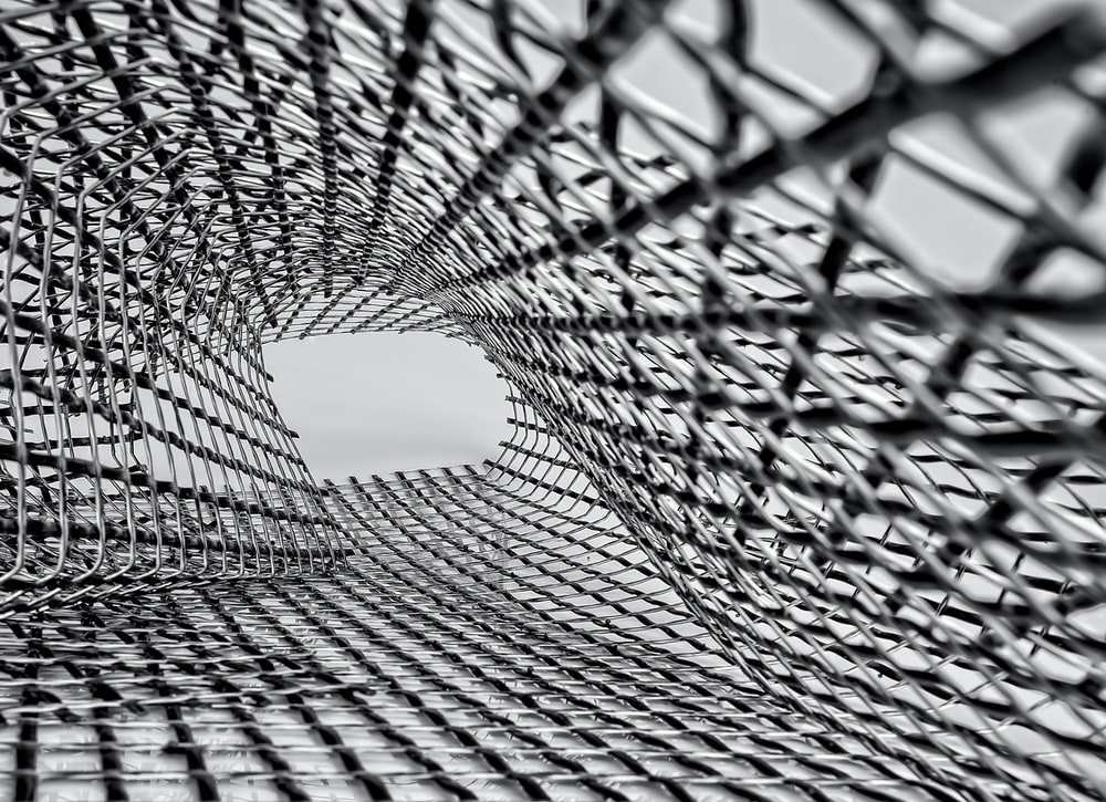 grayscale photo of metal mesh screen
