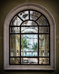 On the wall of an abandoned beachside resort in Punta Cana, hangs this amazing mirror — it must be at least seven feet tall. It reflects both the beauty of the Caribbean palms and ocean, as well as the brokenness of this deserted building.