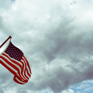 USA flag under white clouds