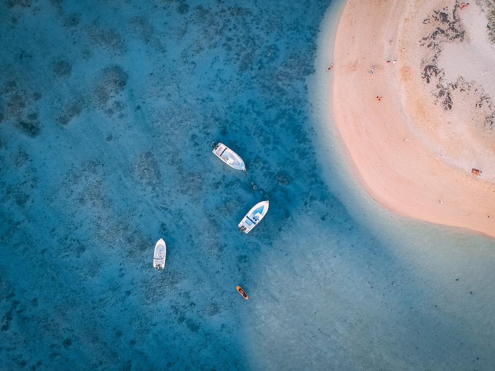 aerial photography of docked boats near island