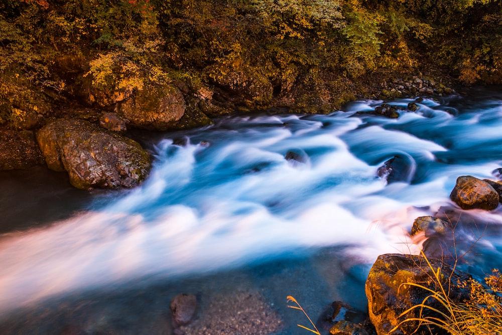 body of water in between of stones