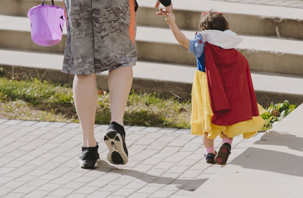 toddler wearing snow white costume