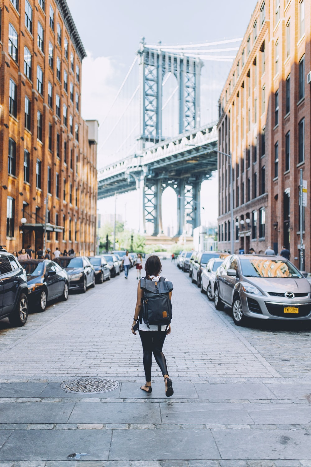 woman walking on a the looking at the bridge