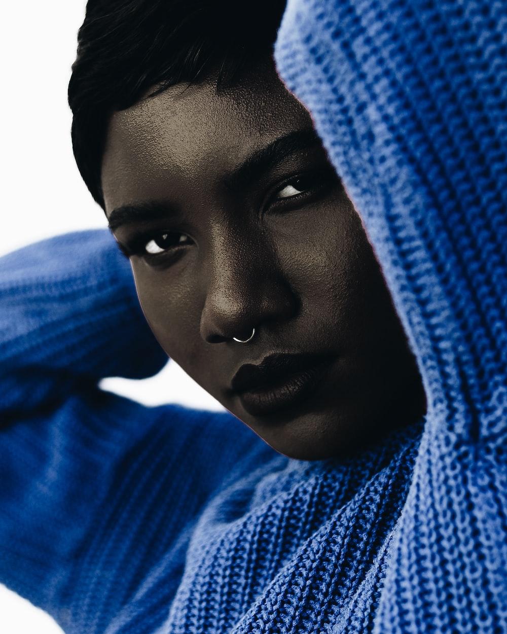 woman wearing blue knit sweatshirt