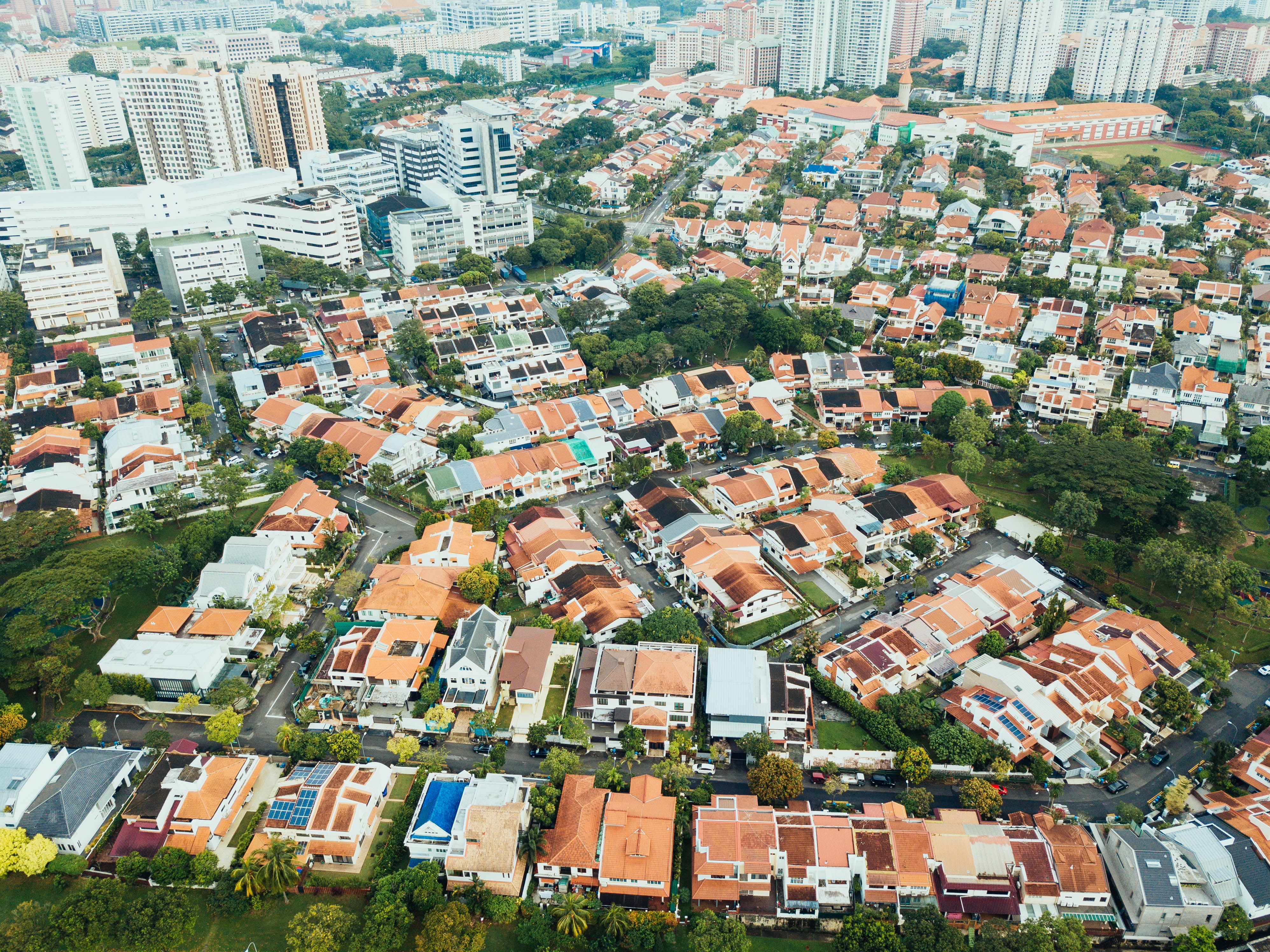 aerial photography of villages near high-rise buildings during daytime