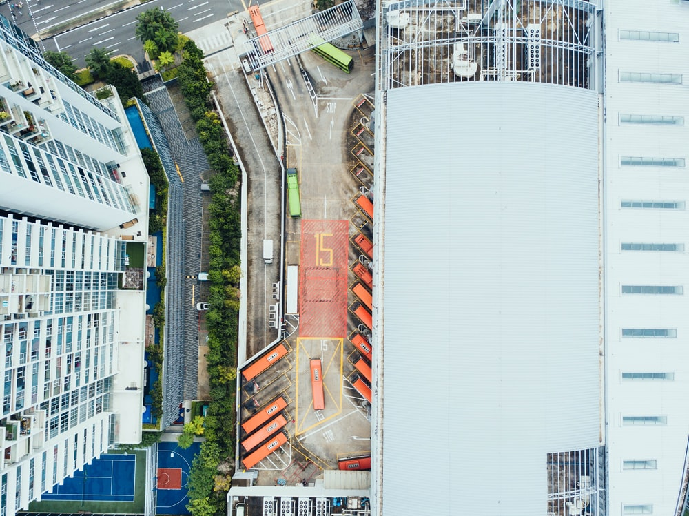 bird's-eye view photography of high-rise building beside asphalt road
