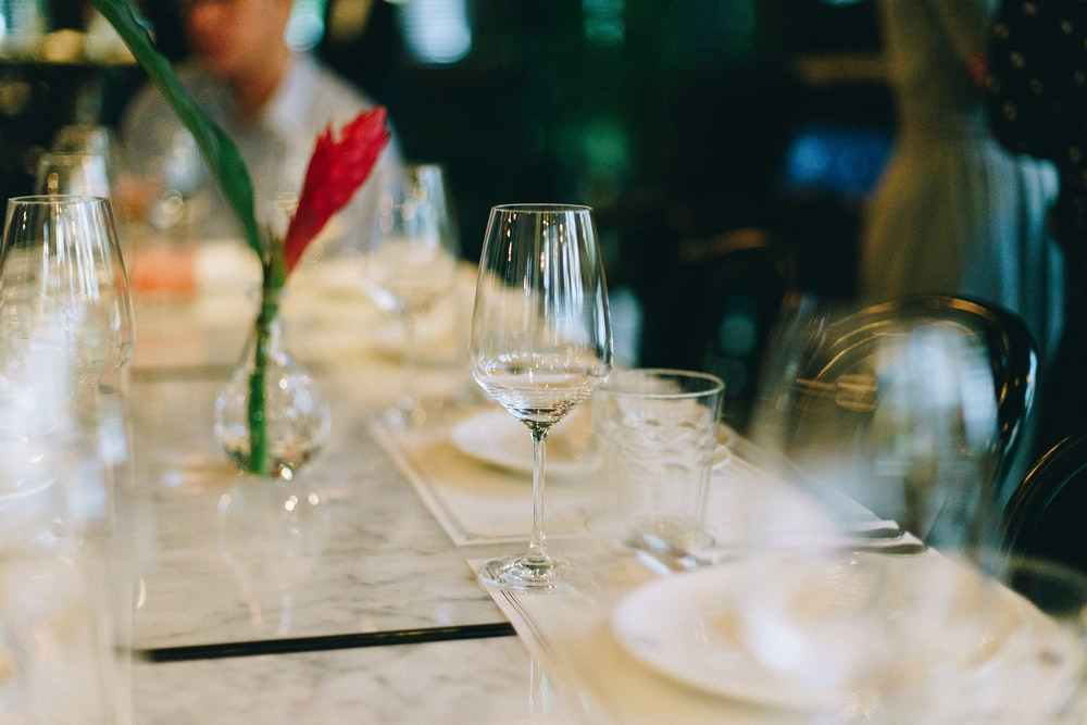 selective-focus photography of wine glass on table