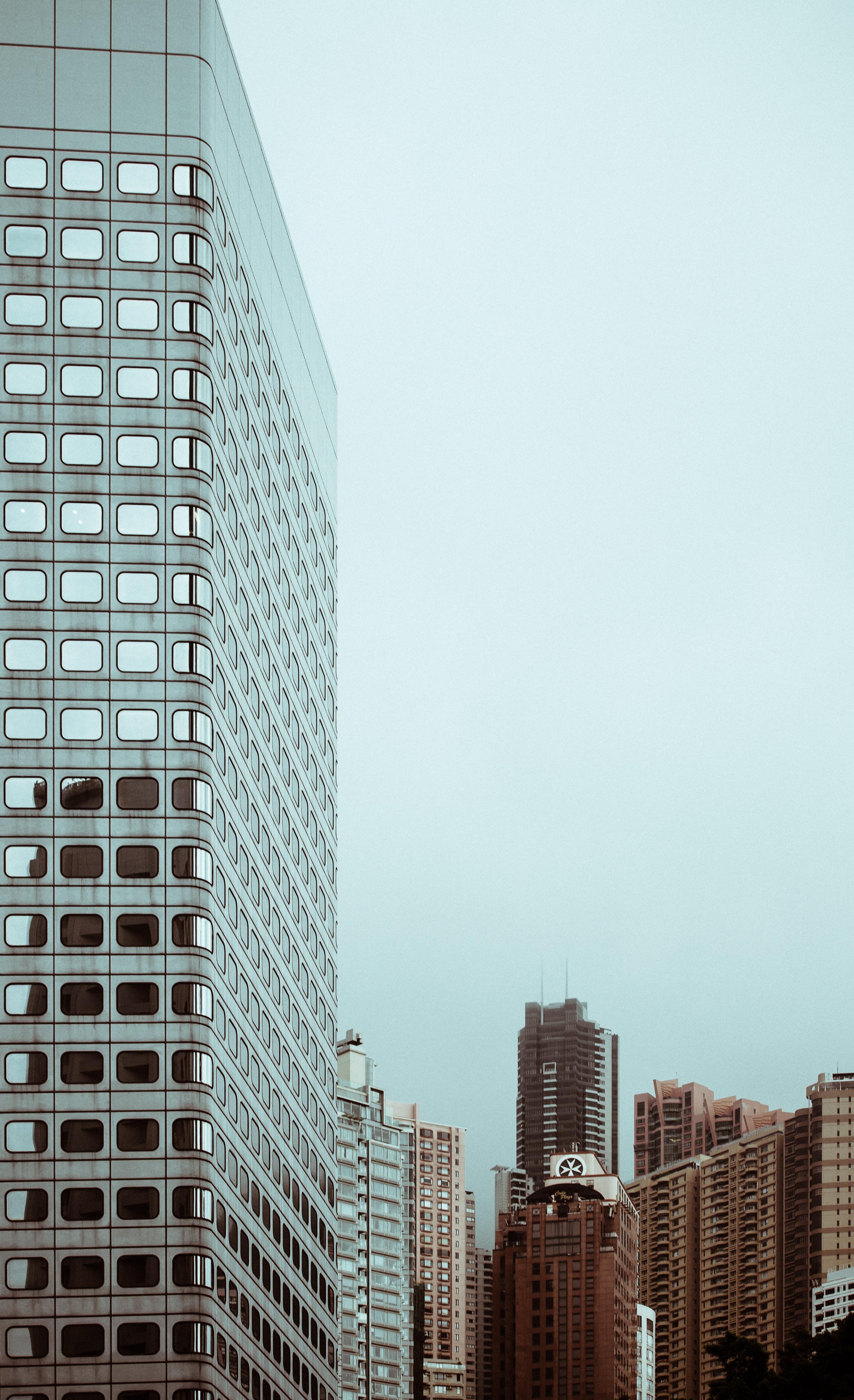 photo of concrete city buildings