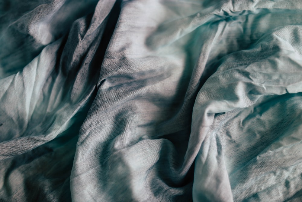 teal and grey textile