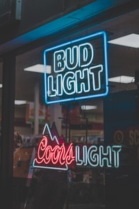 Bud Light above Coors Light neon signages