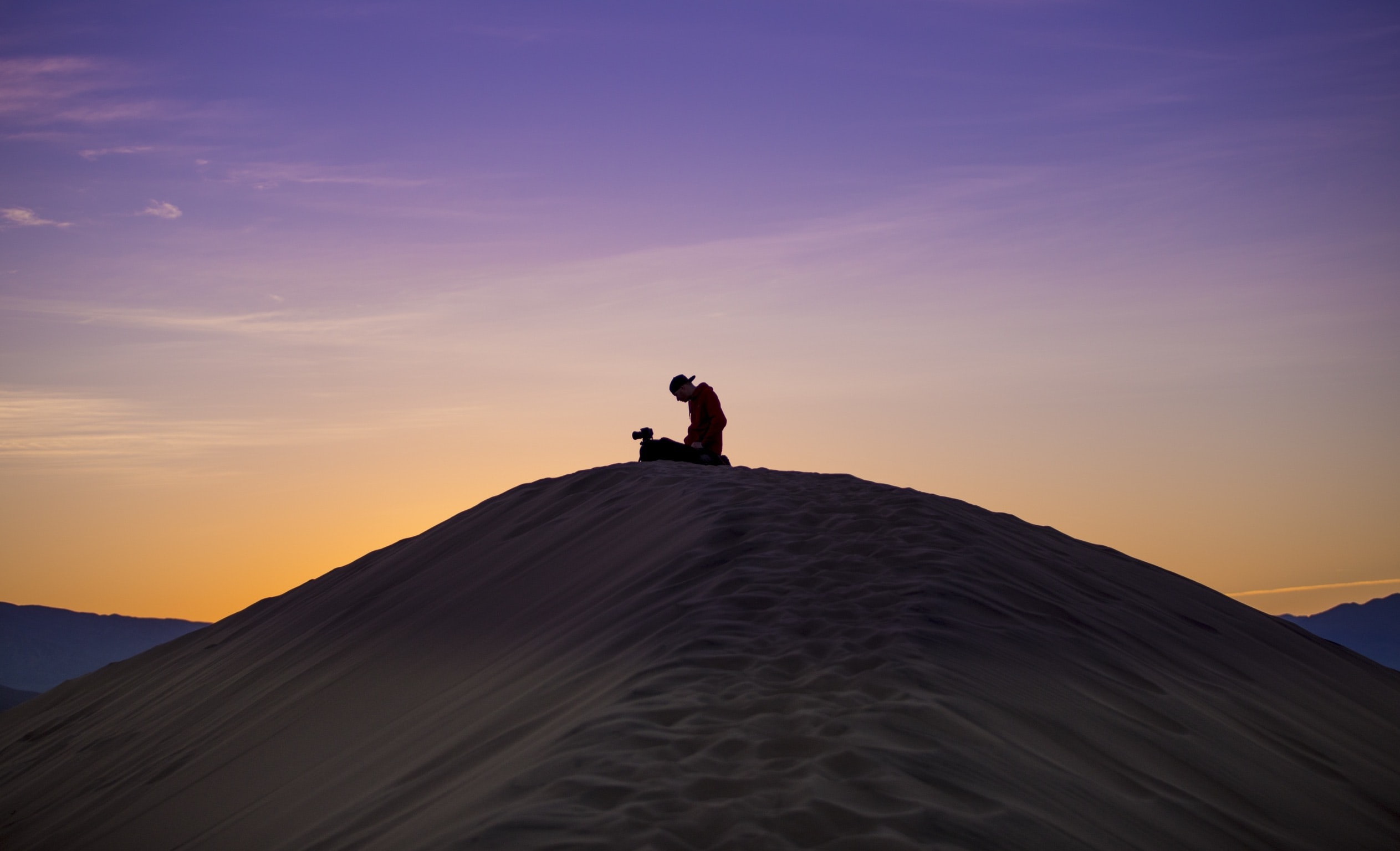 silhouette of man and woman on desert