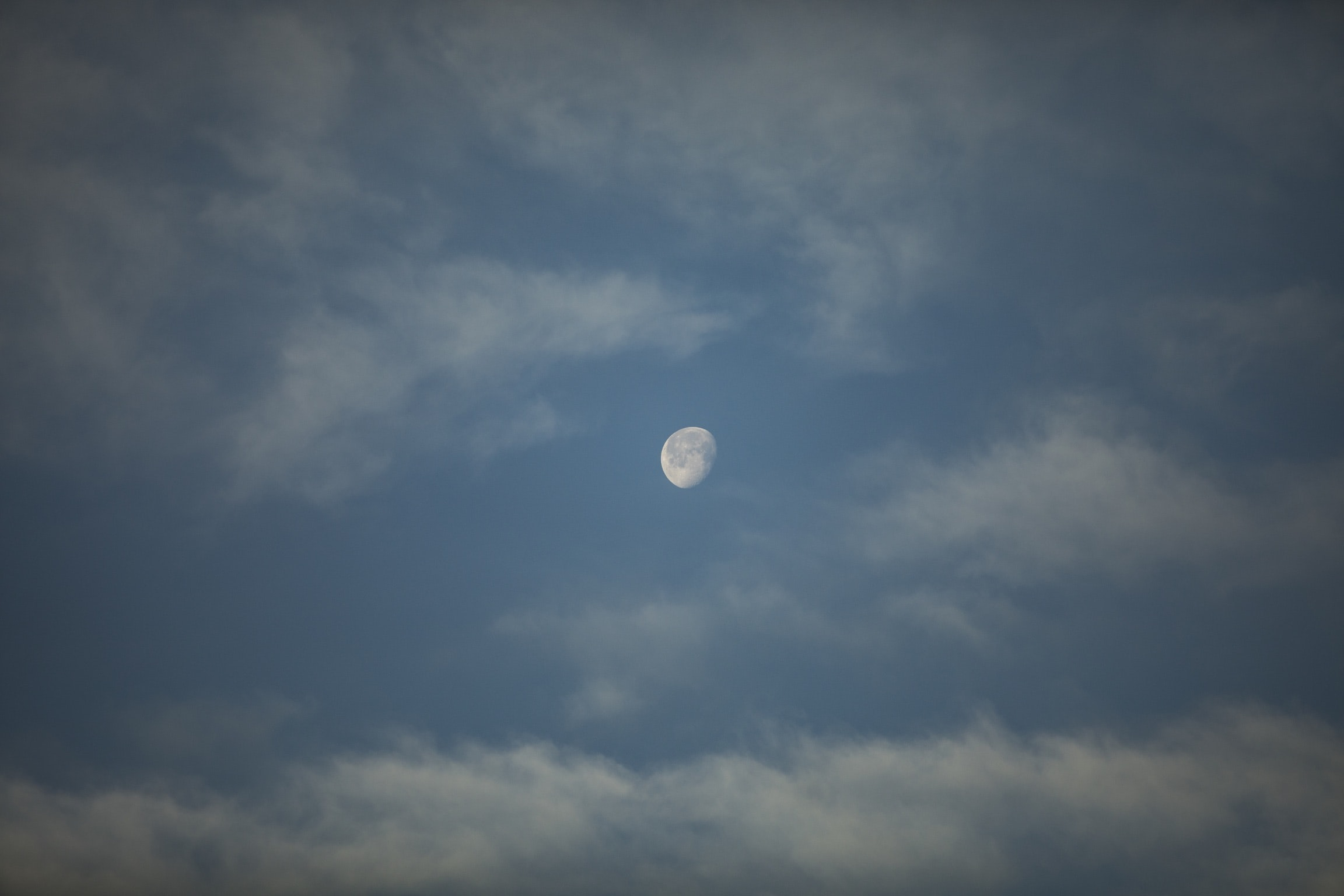 moon on white and blue sky