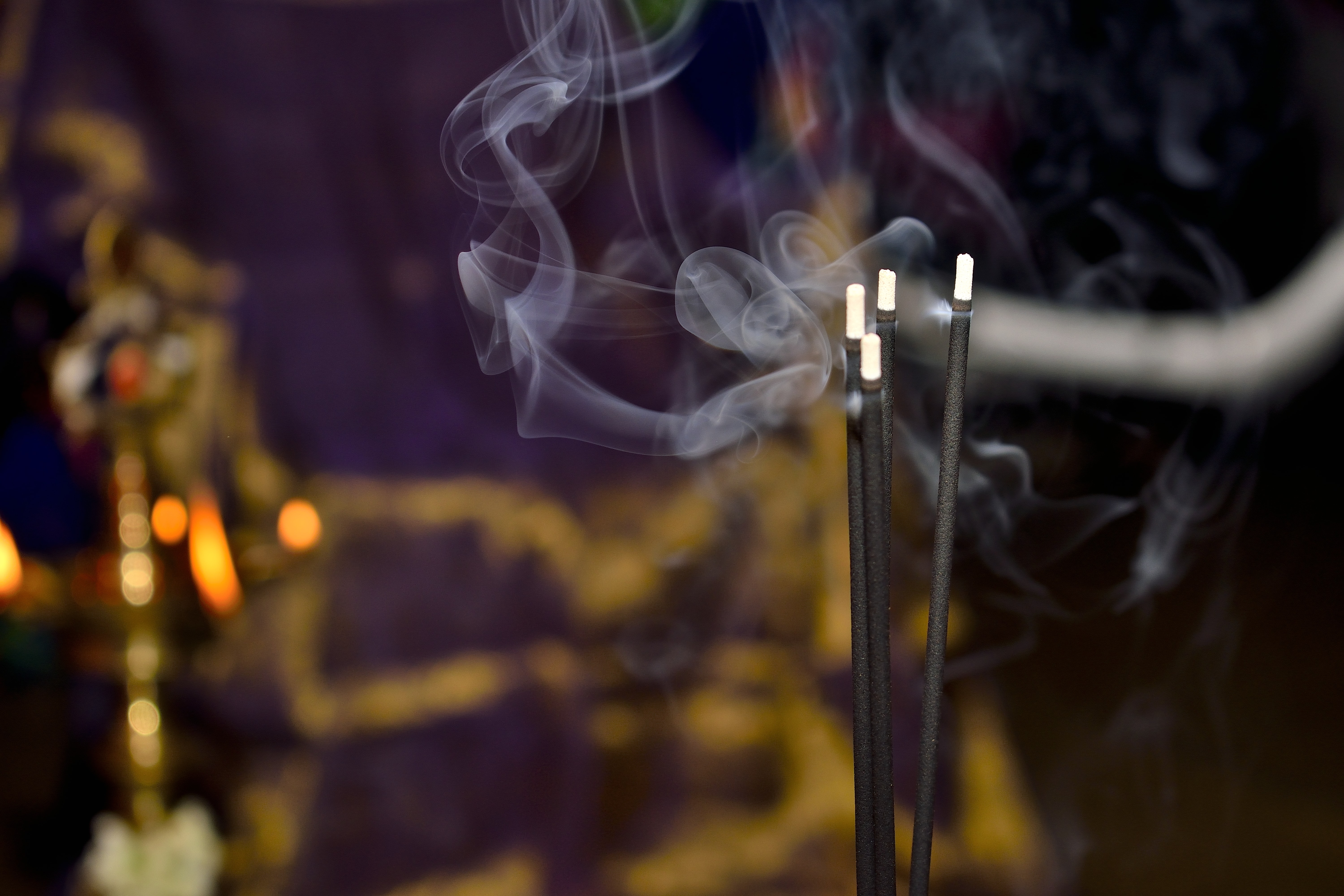 shallow focus photography of incense