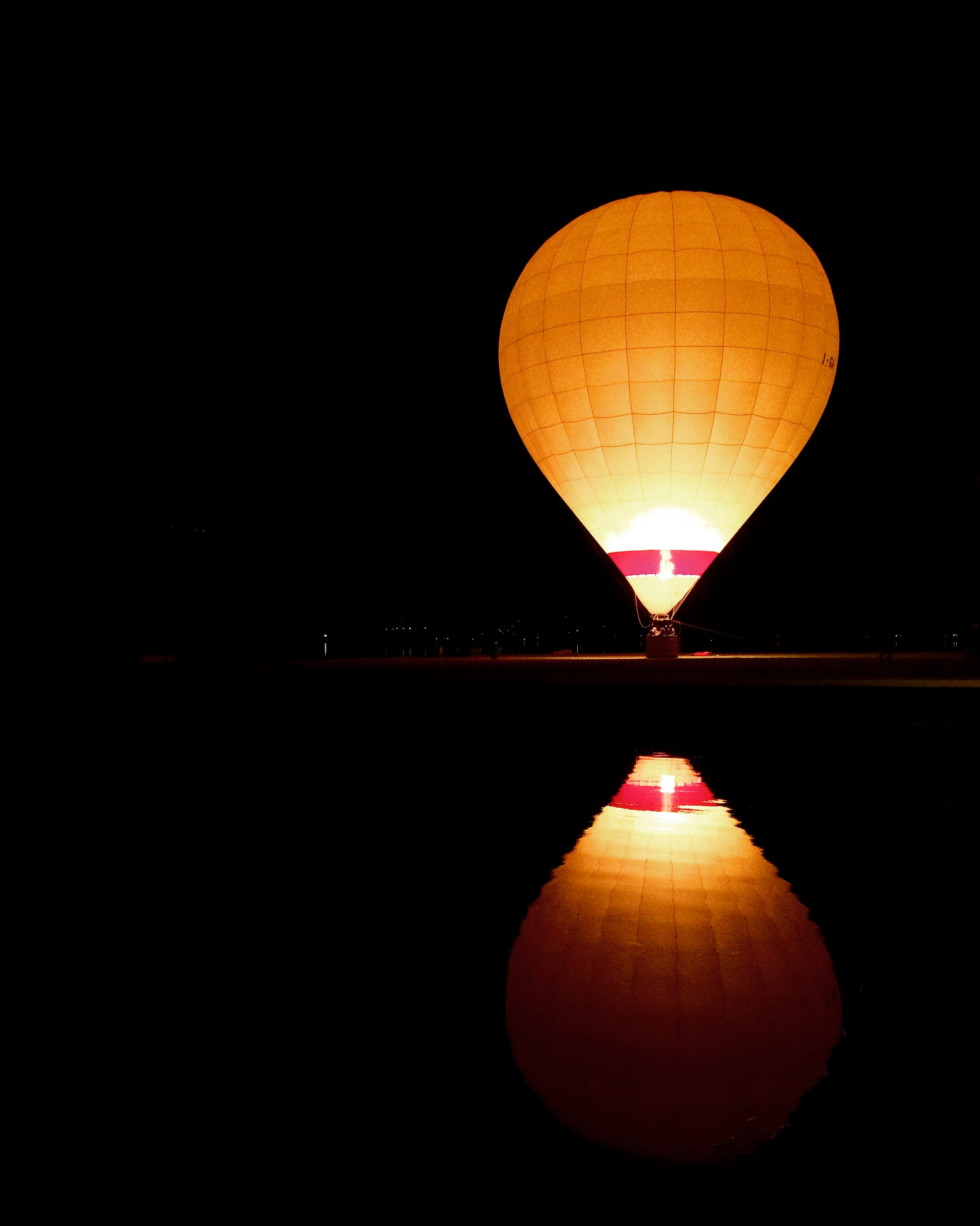 photography of brown and white hot air balloon at nighttime