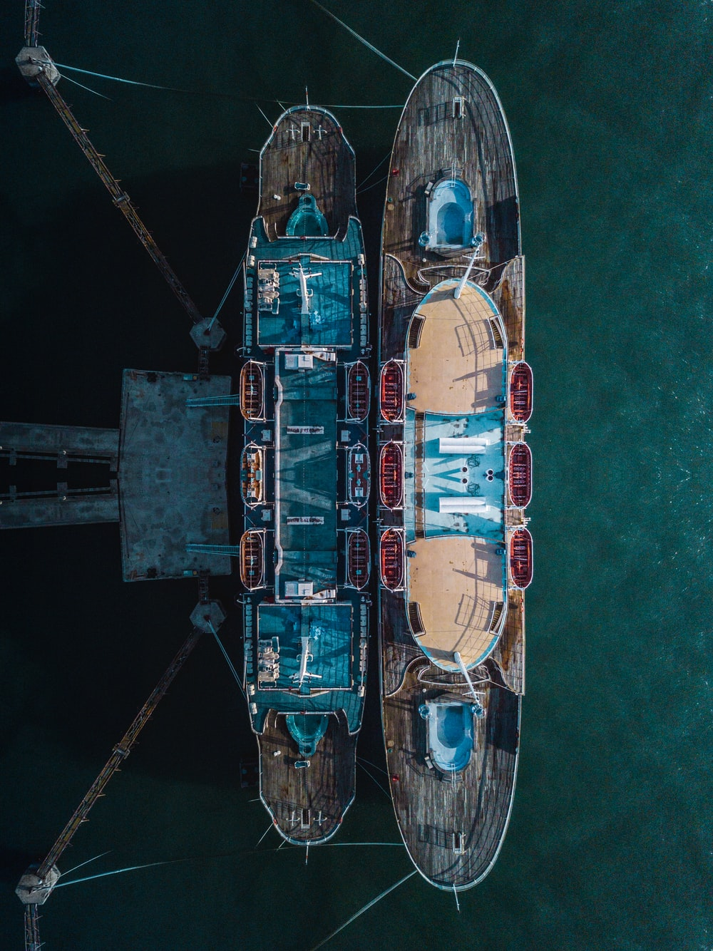 two brown-and-blue boat dock in aerial photography