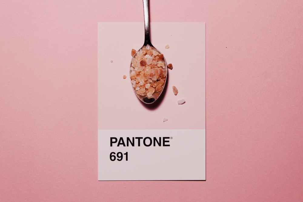 silver spoon with Pantone 691 text overlay