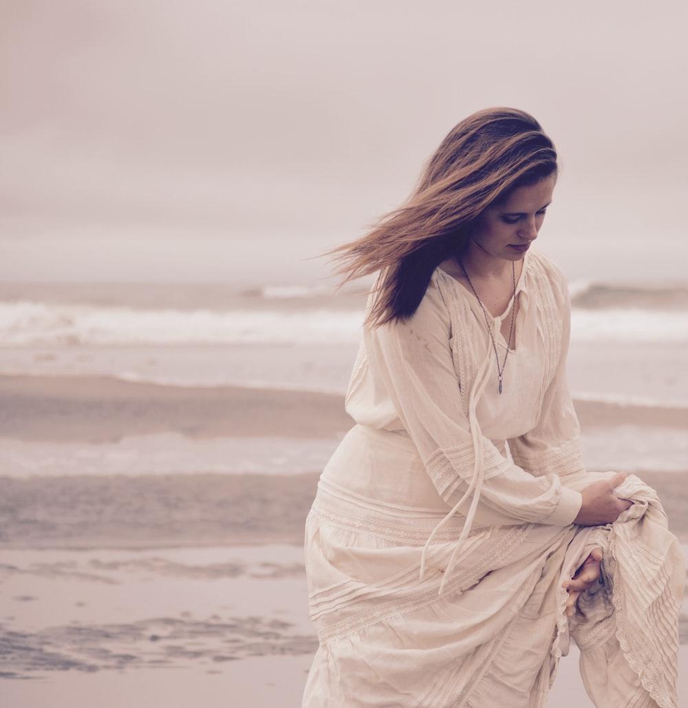 woman standing on the seashore