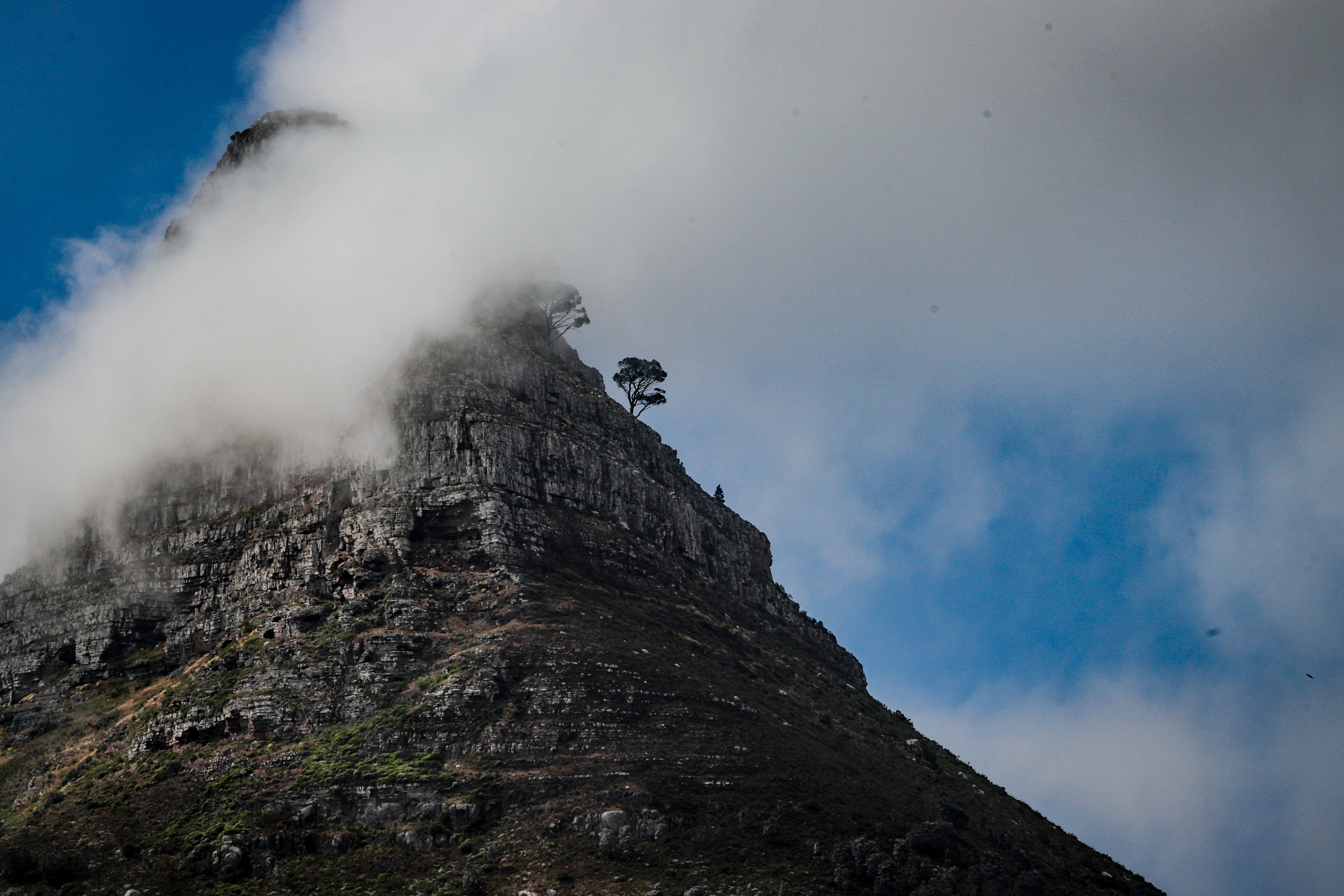 landscape photo of gray rock mountain covered with clouds
