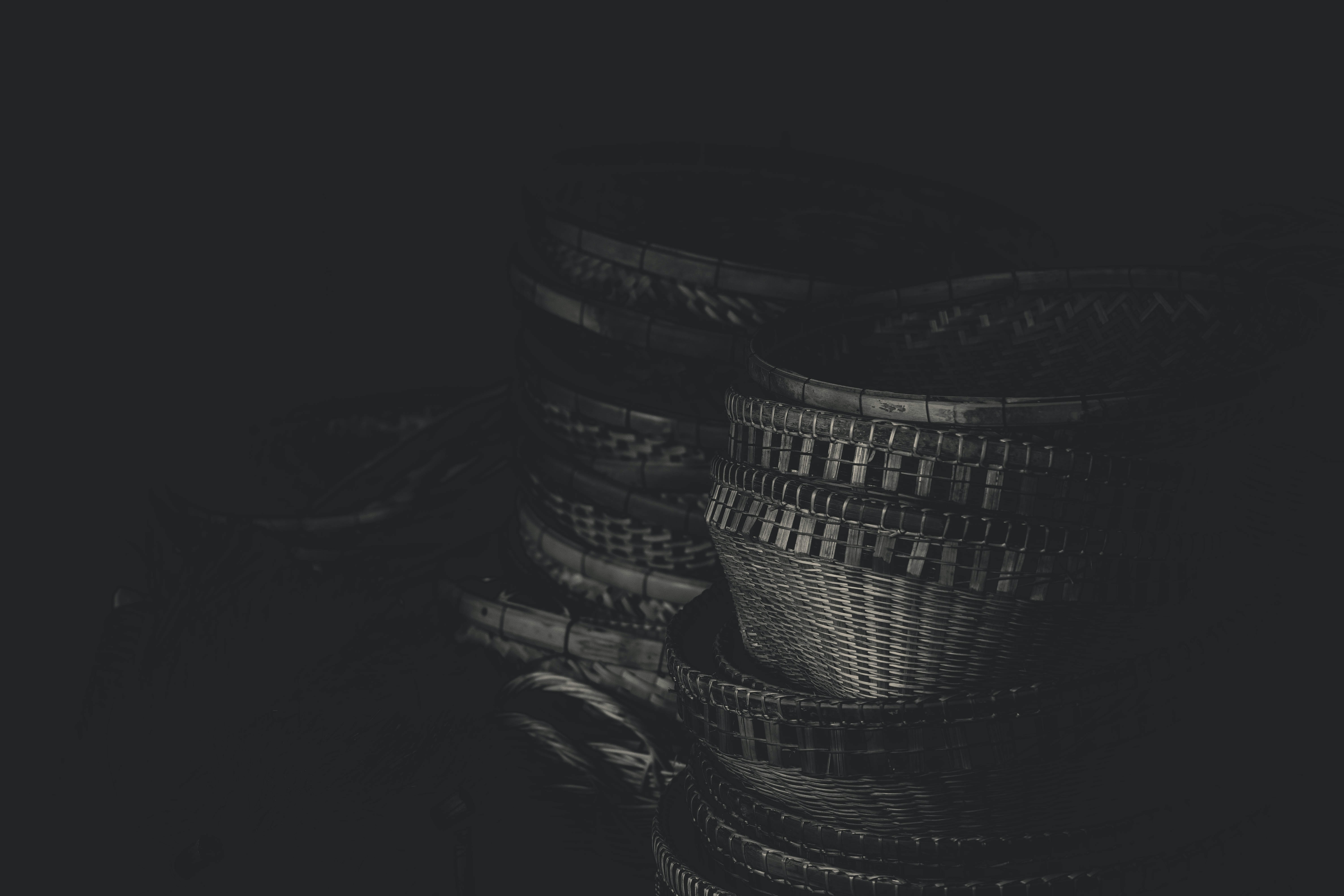 grayscale photography of wicker baskets