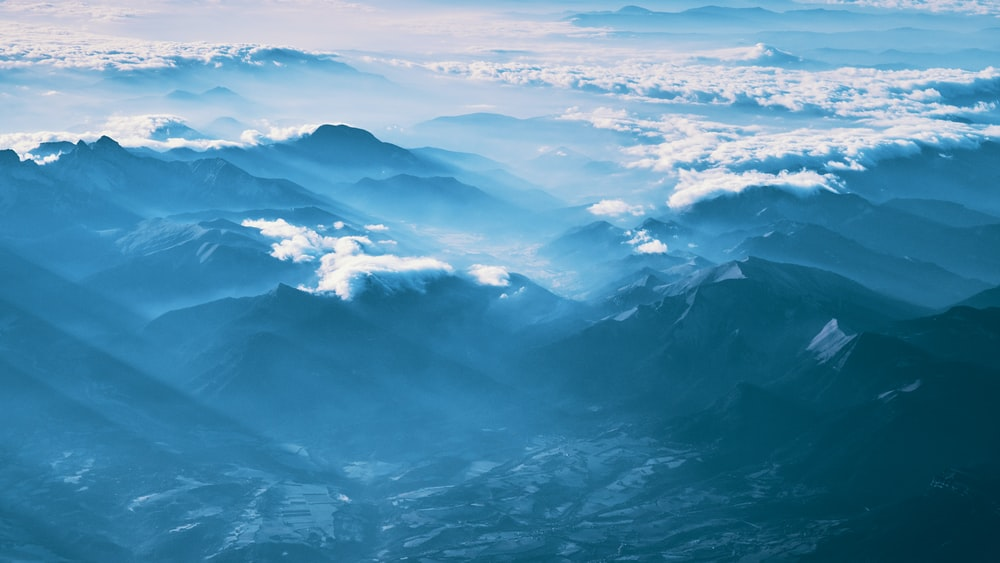 mountain covered with fogs during daytime