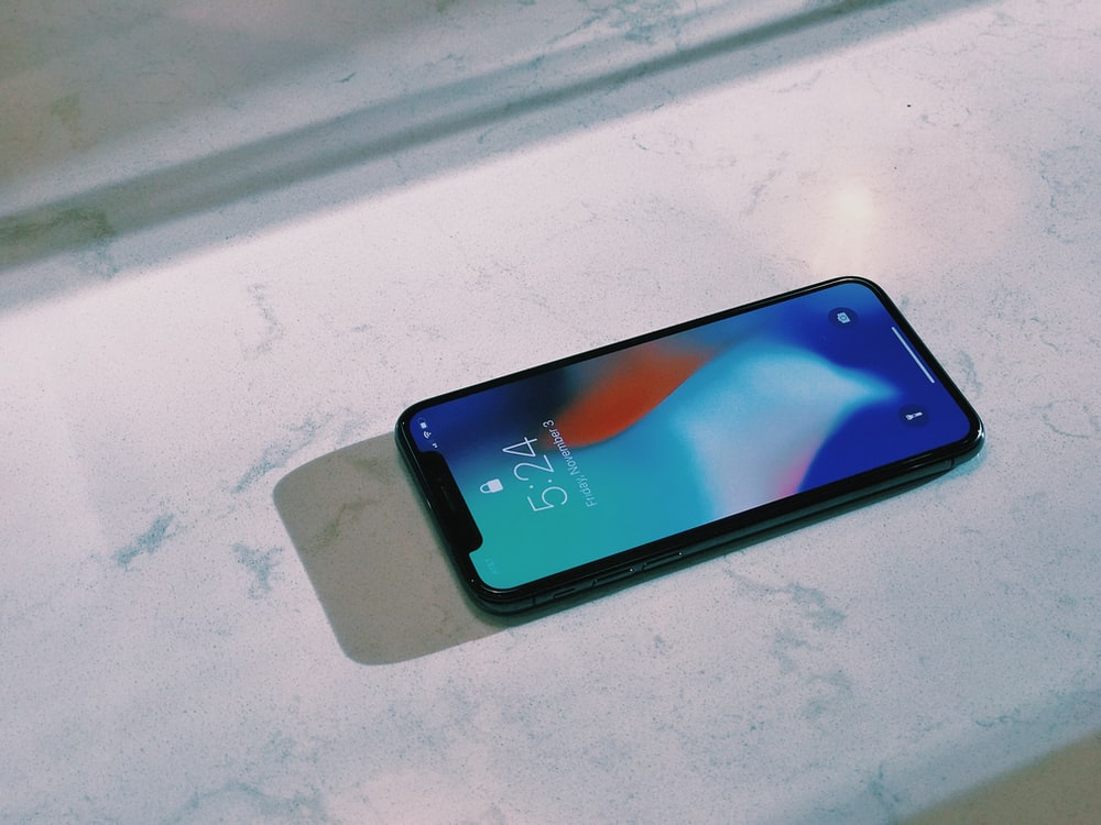 turned on silver iPhone X