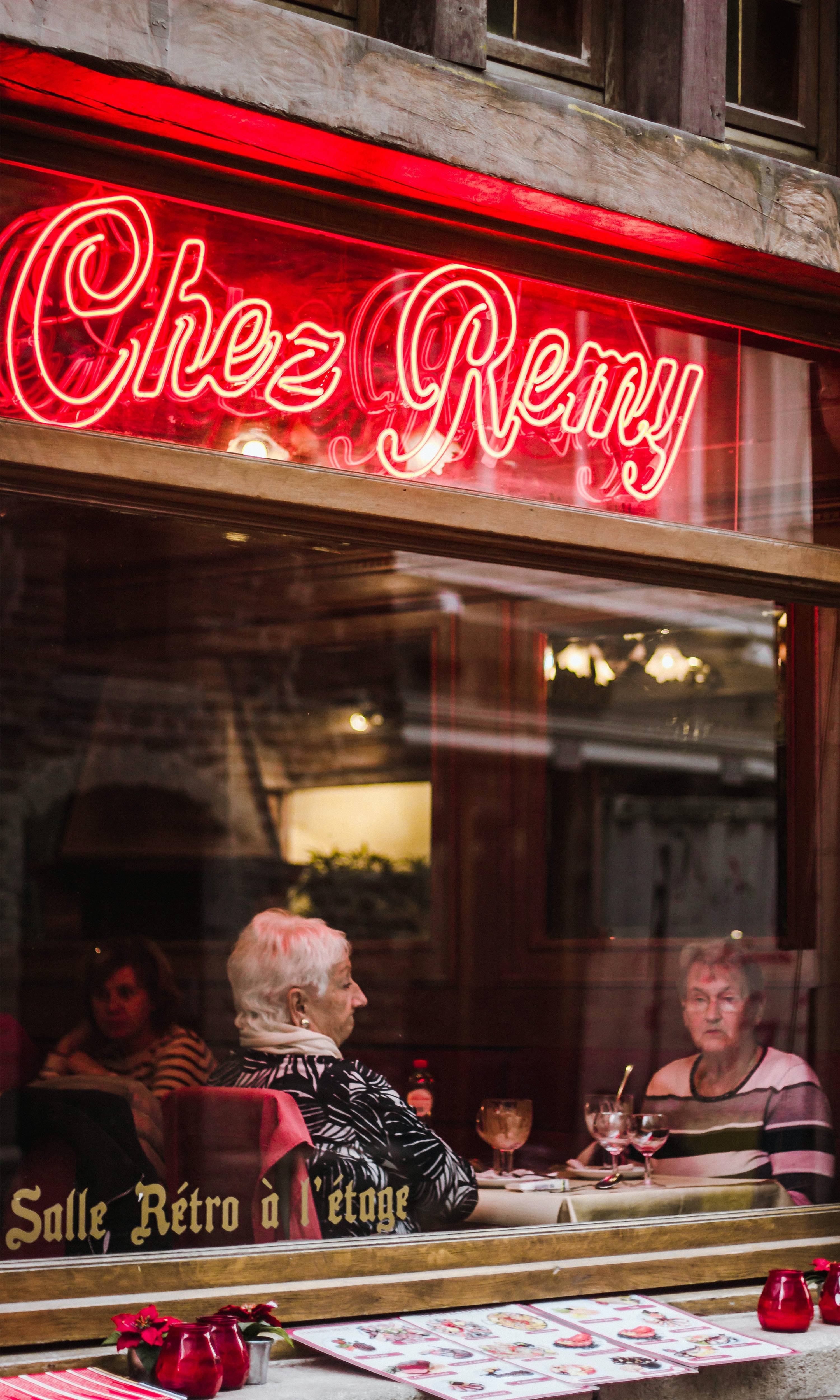 turned on Chez Remy neon signage during daytime