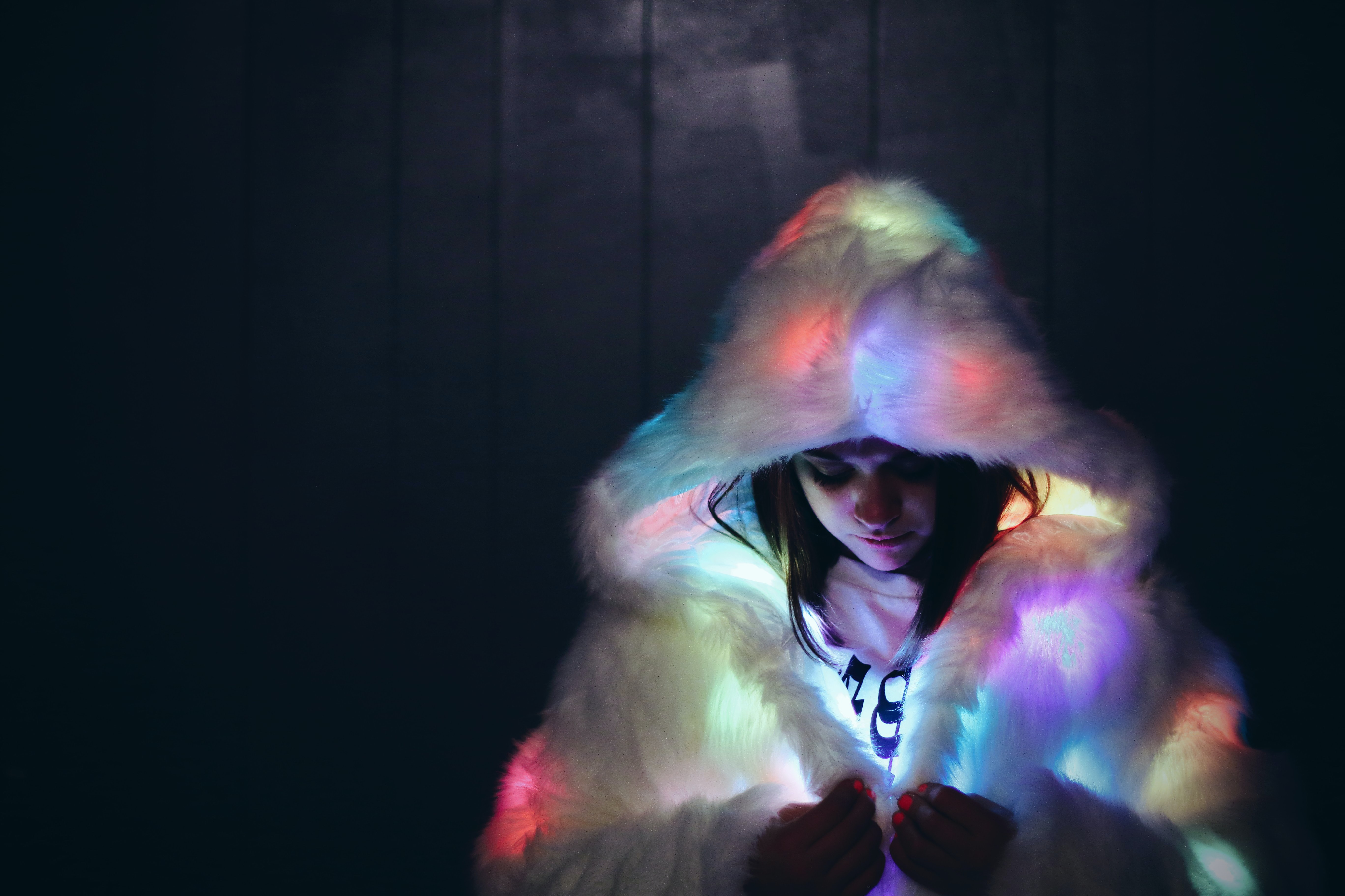 woman wearing lighted furry coat