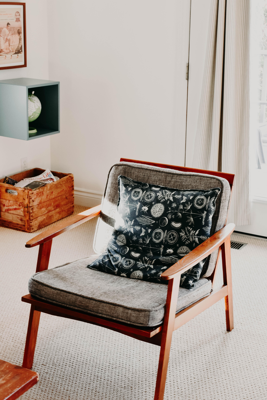 gray padded armchair