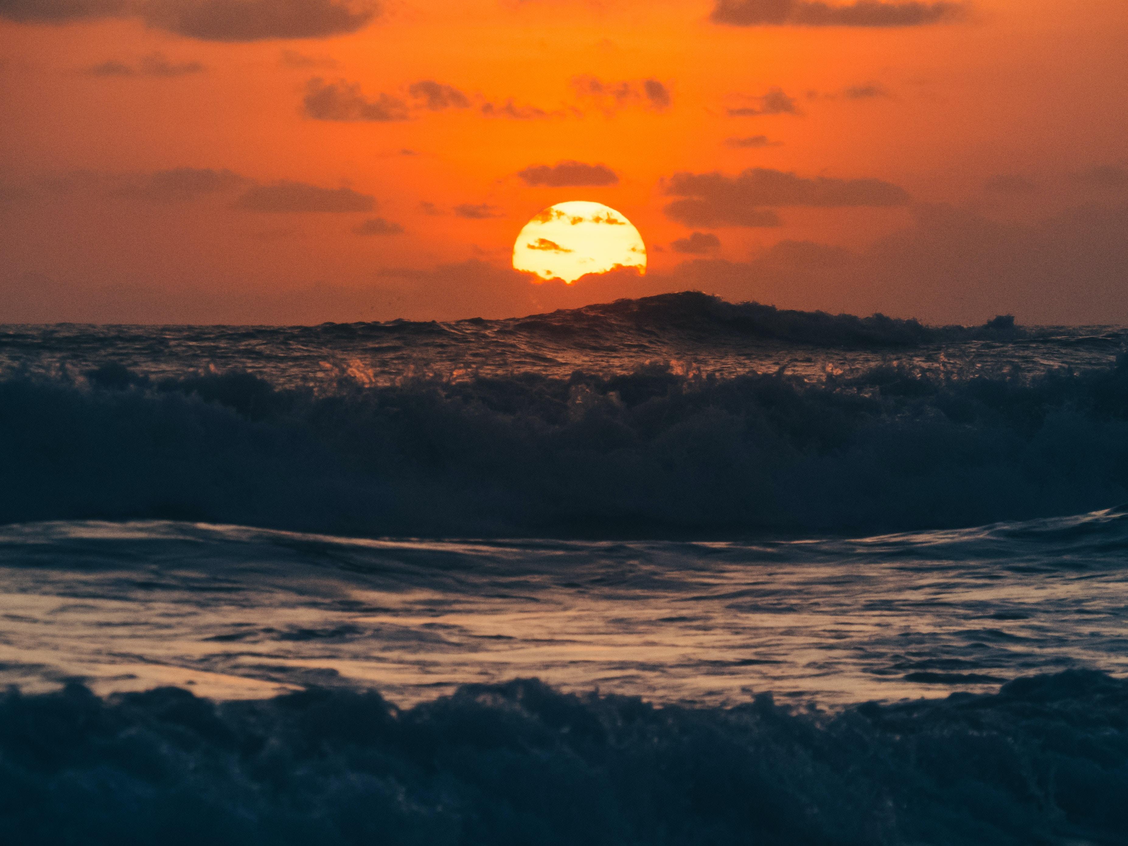sea waves during sunrise painting