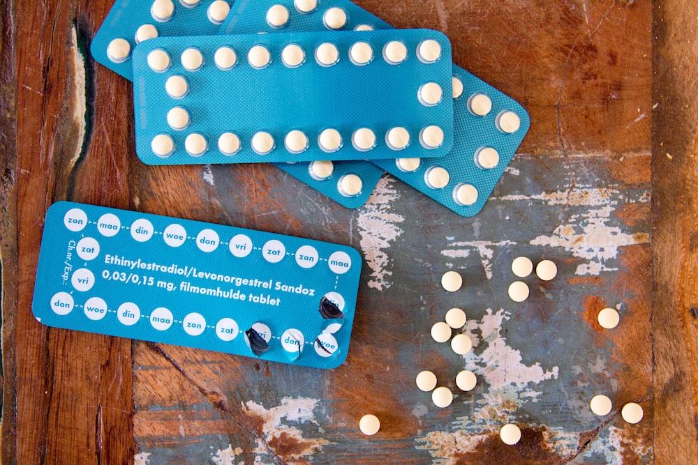 four blue blister packs