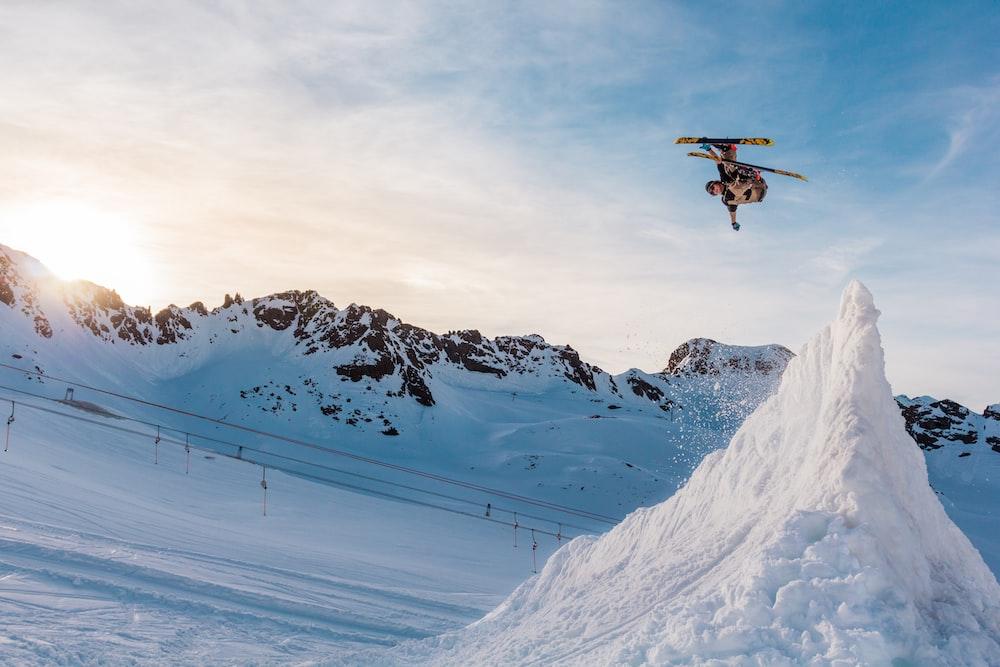 snow ski player ramping on the ice mountain