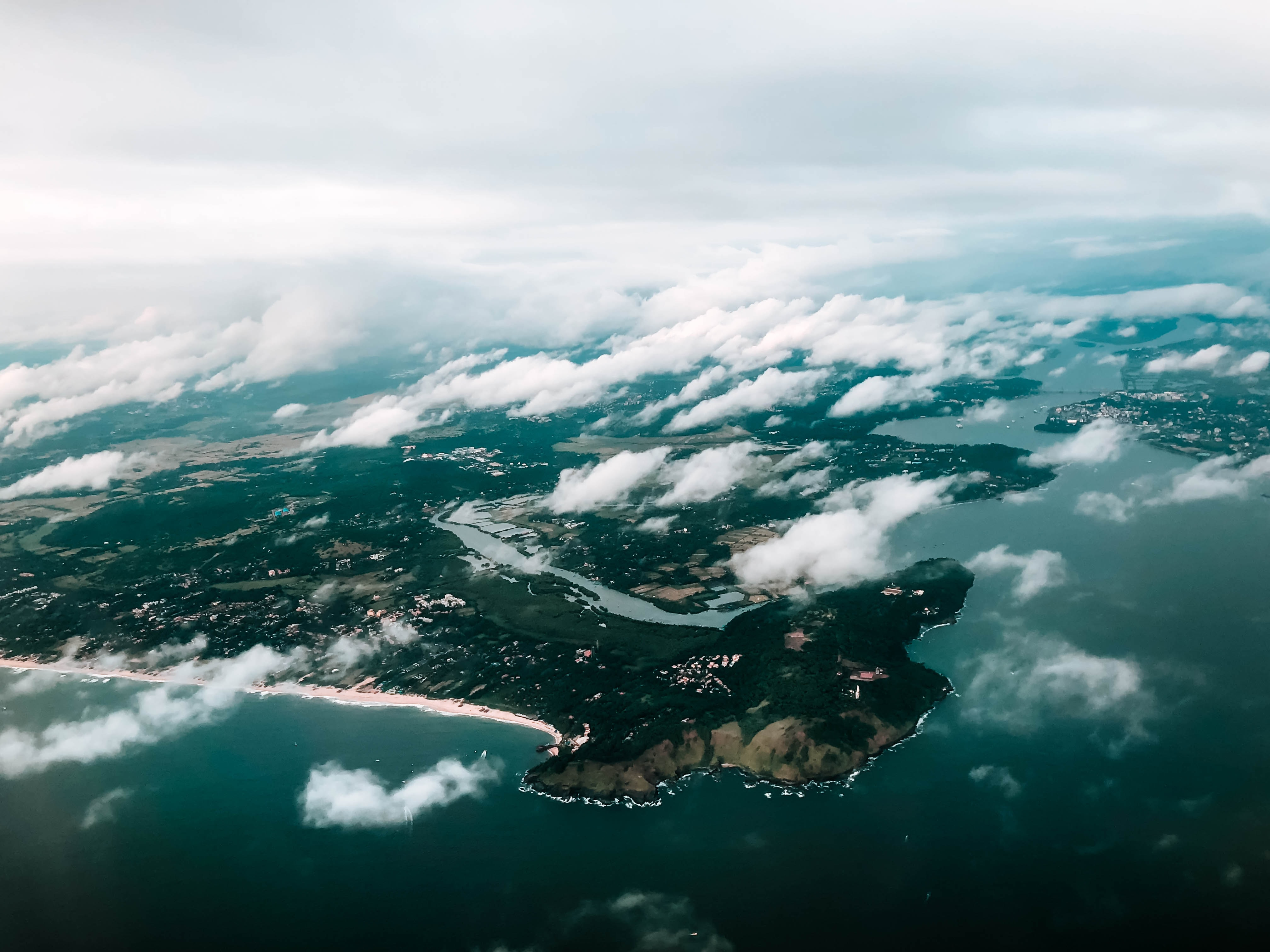 aerial photography of island and clouds