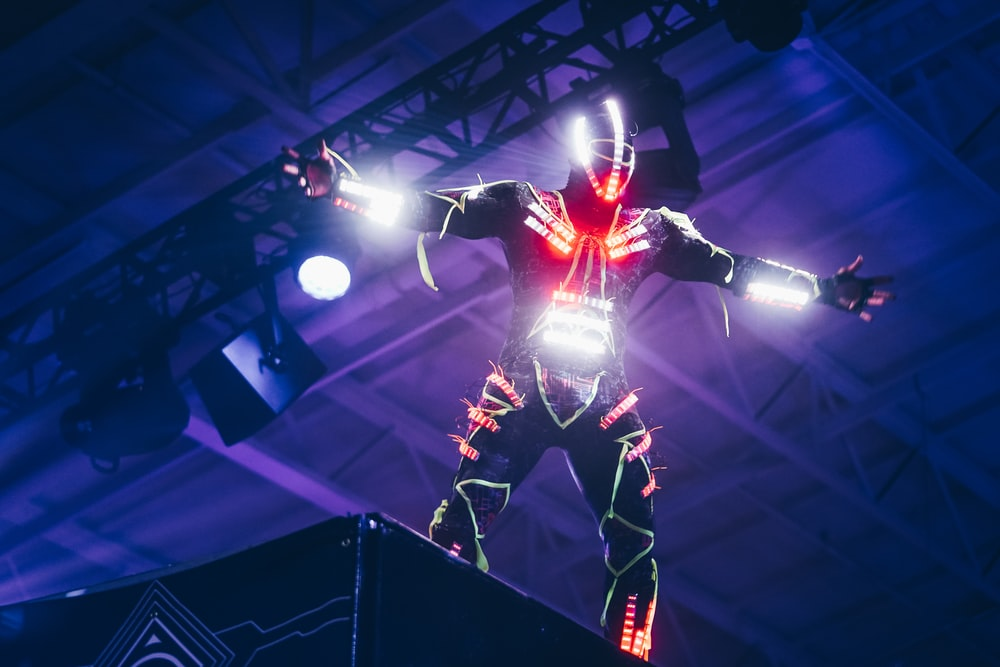 person wearing white and red LED light suit