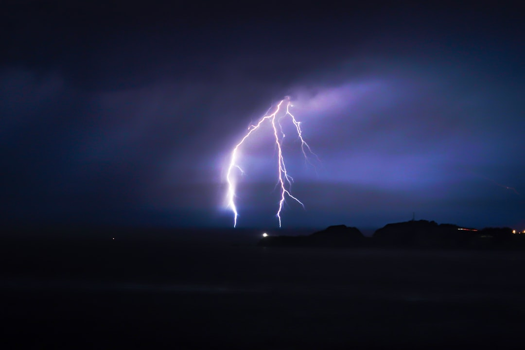 Lightning off of the Marin coast, looking from the Golden Gate Bridge.