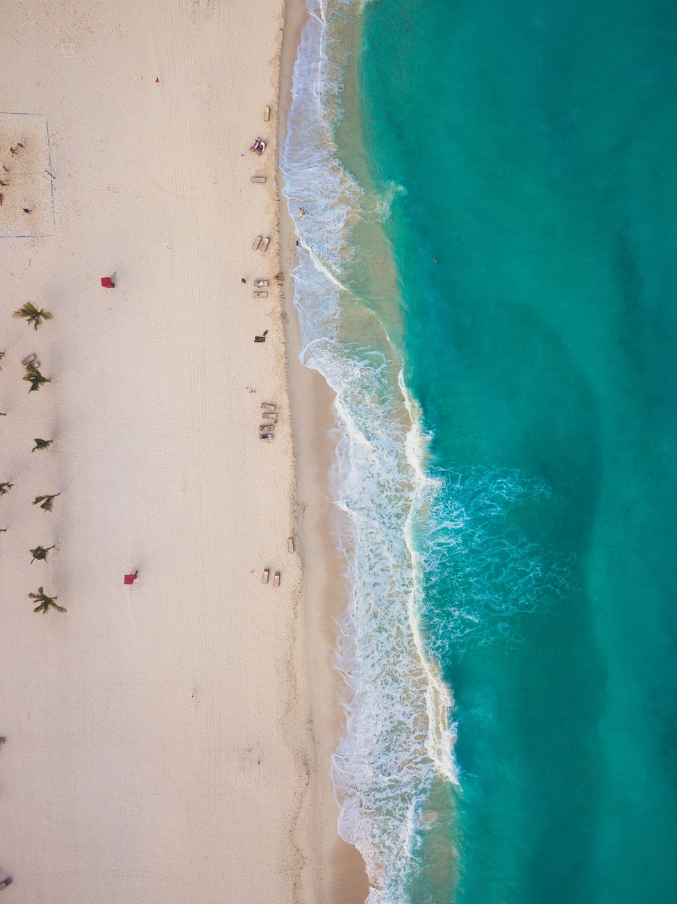 aerial view of the white sand beach in cancun