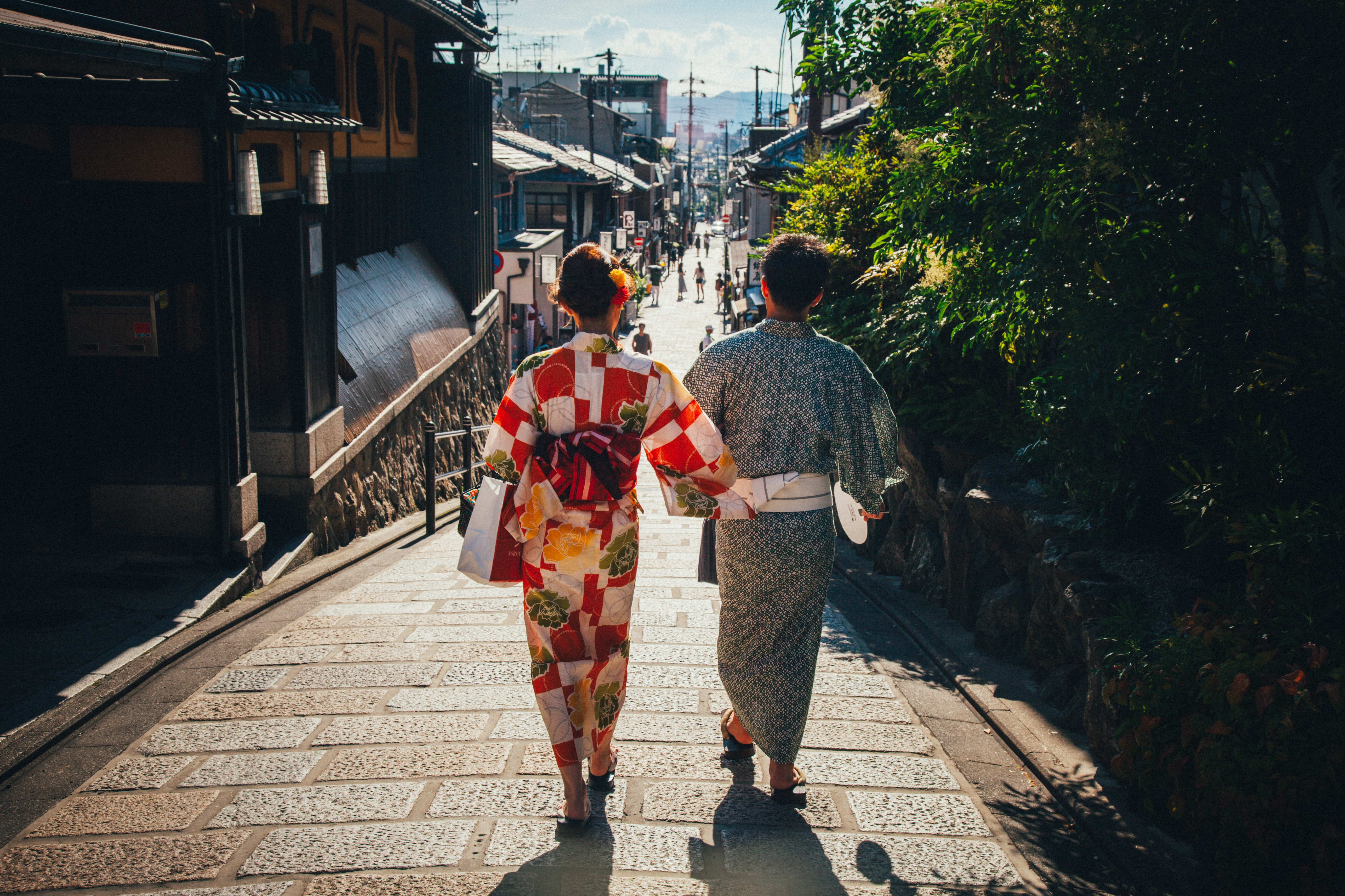 man and woman walking on the road