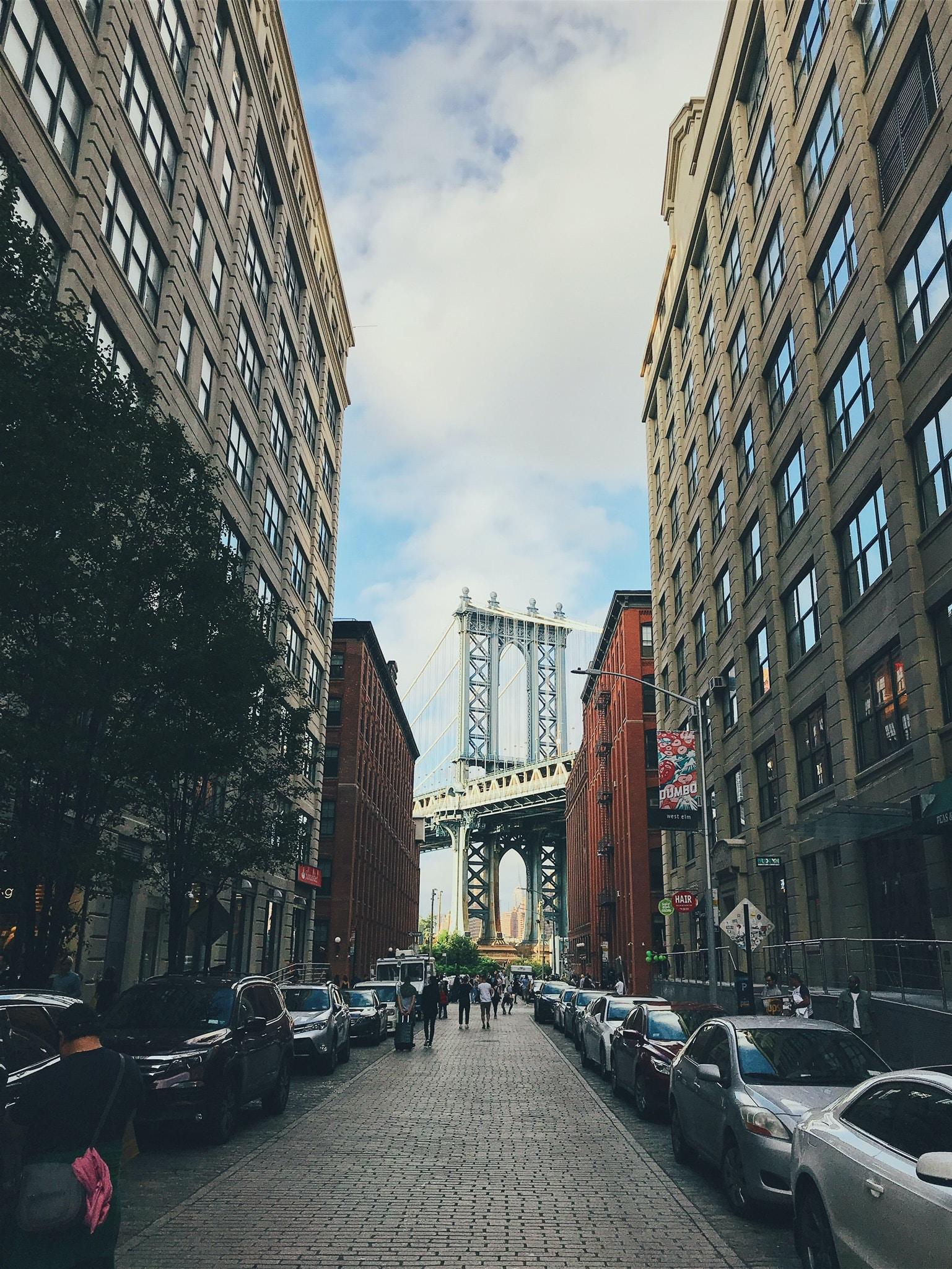 group of people walked in street in front of Manhattan bridge