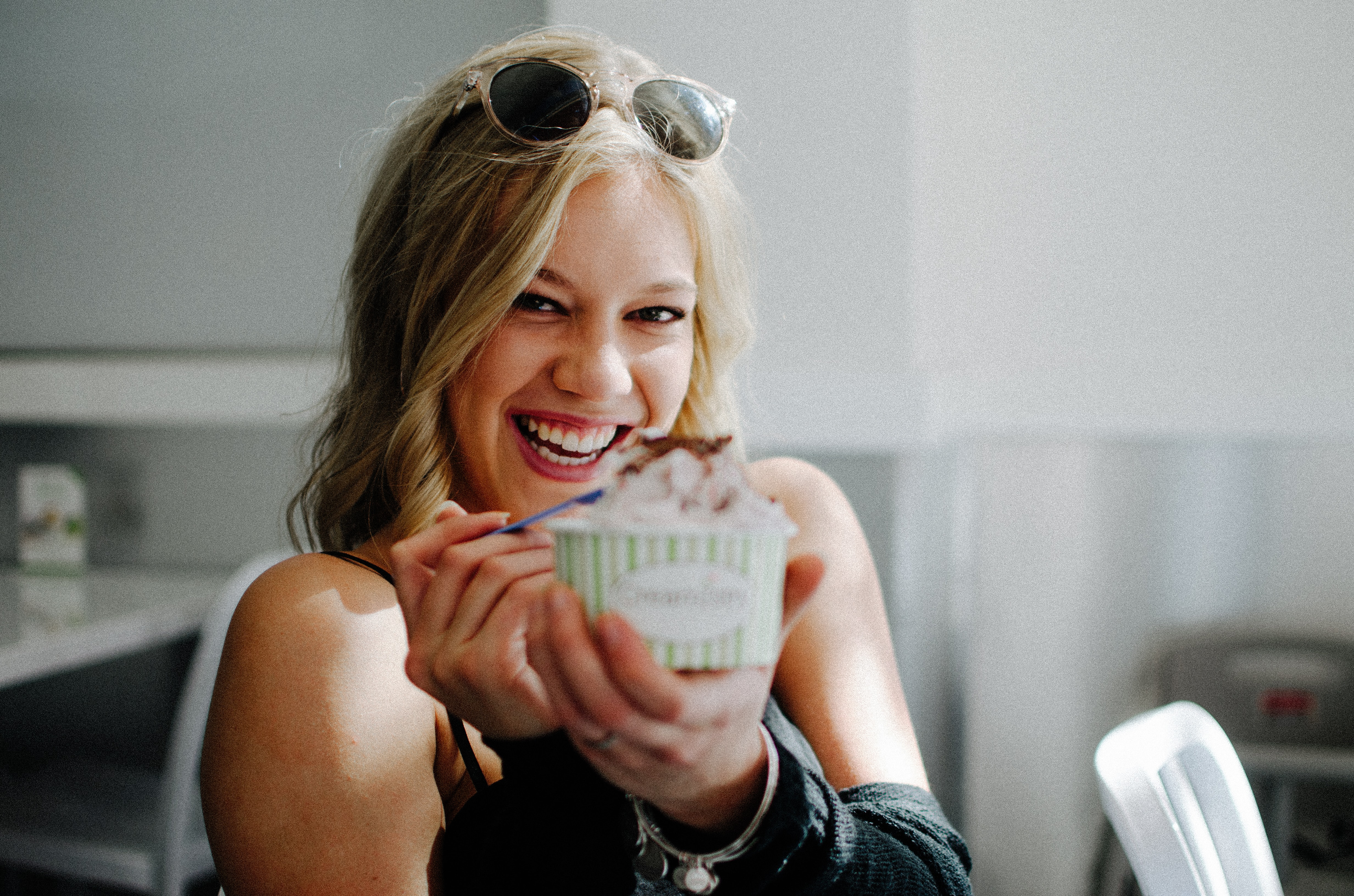 woman in black top holding disposable cup
