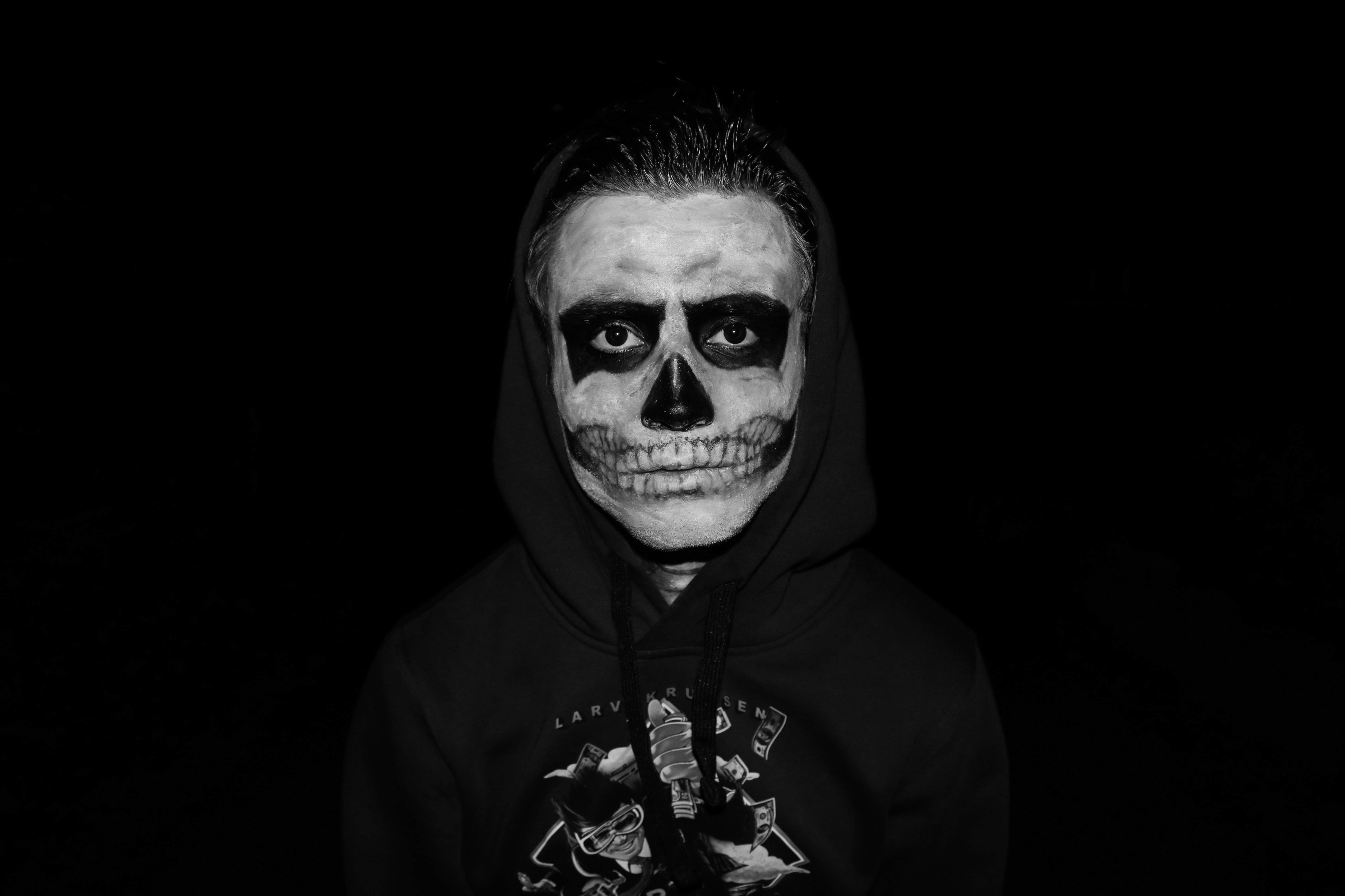 person wearing skull makeup