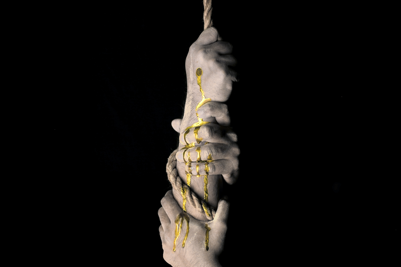 three hands grabbing on rope graphic wallpaper