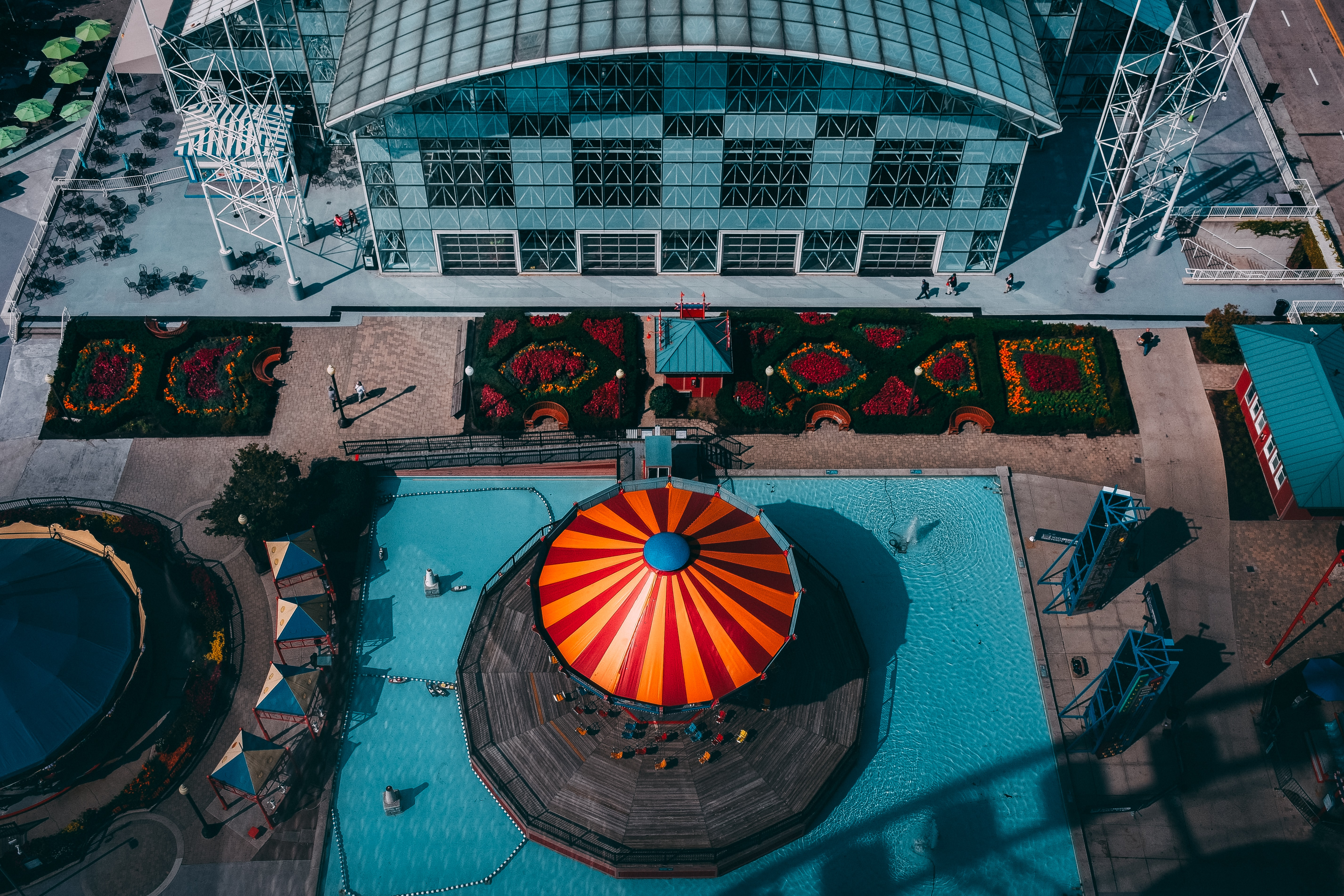 aerial photography of orange and red umbrella