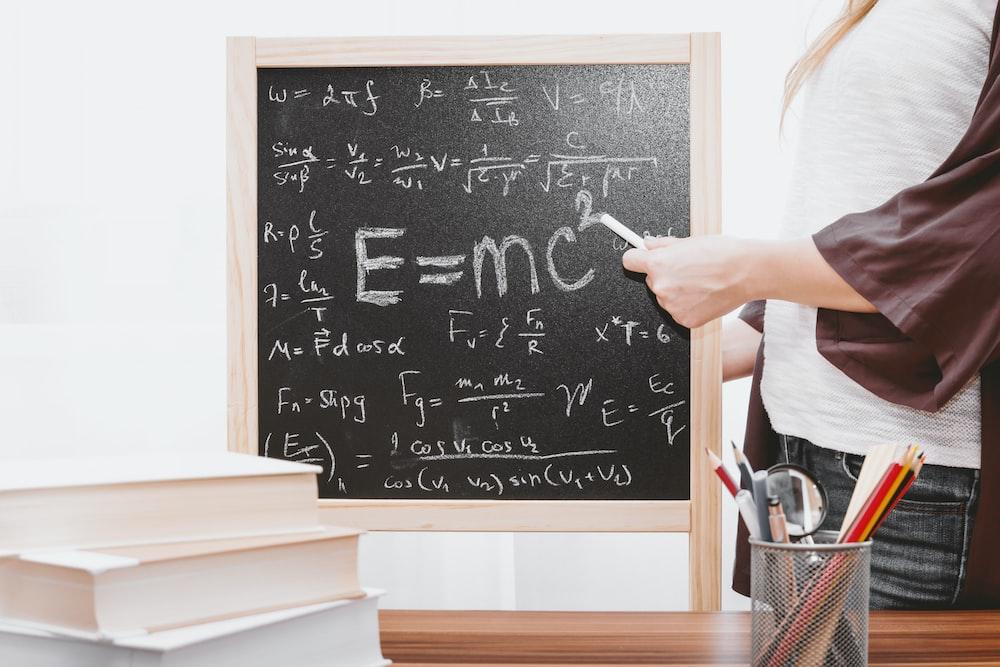 E-mc2 written on chalkboard