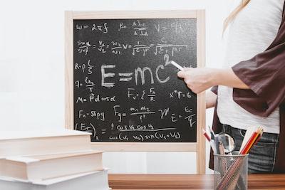 e-mc2 written on chalkboard math teams background
