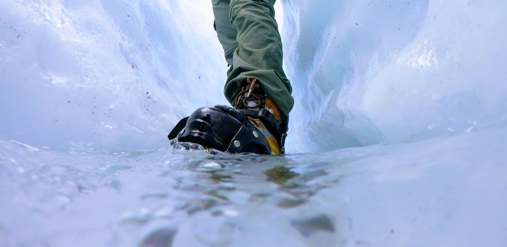 closeup photo of person standing on ice surface