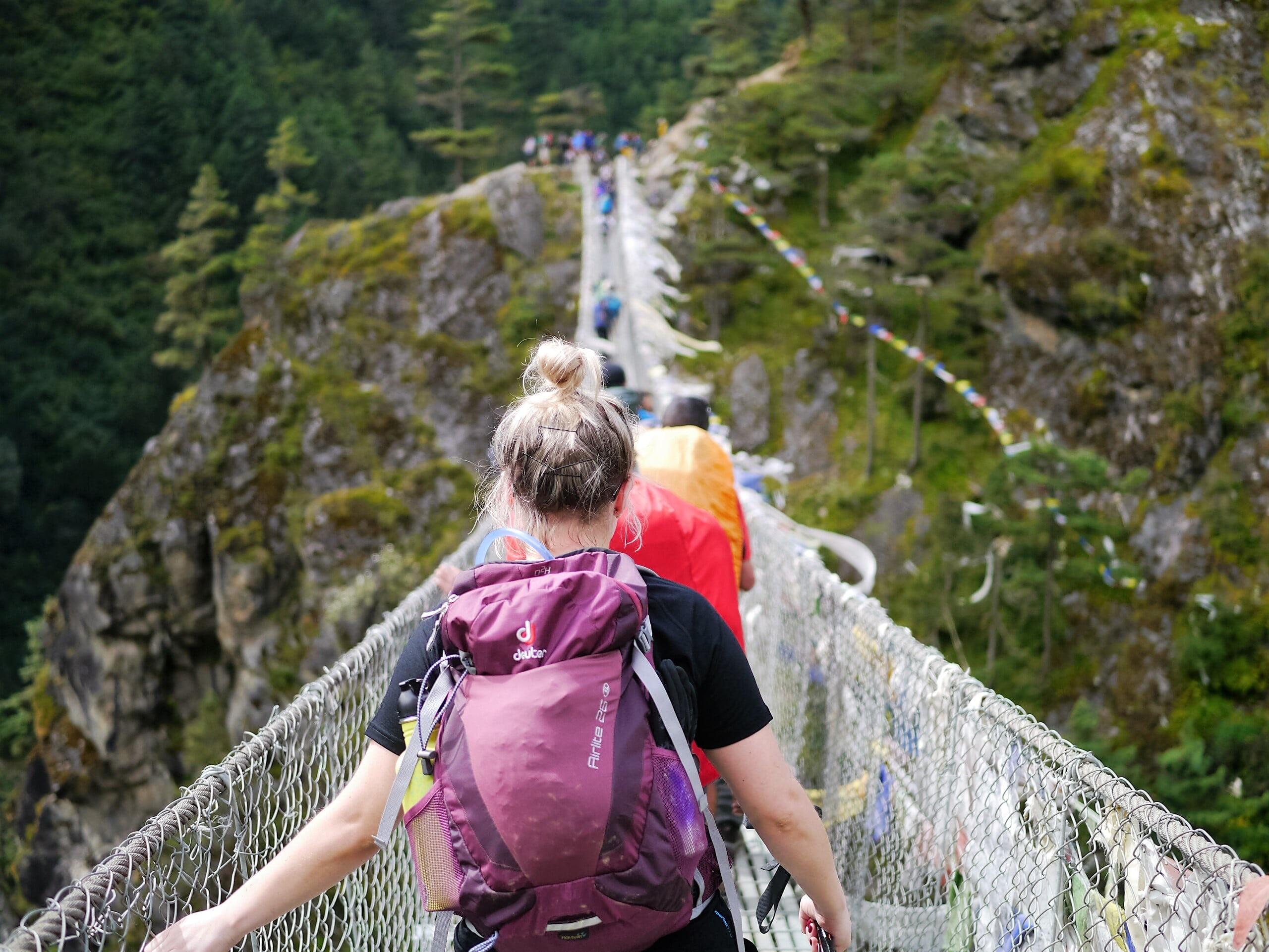 people on hanging bridge during daytime